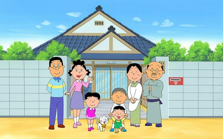 """An image from the """"Sazae-san"""" TV cartoon series -- the world's longest-running -- with the character Sazae-san (2nd L) and her family in front of their house, is shown in this handout received from the Hasagawa Michiko Art Museum in Tokyo (AFP Photo/Handout)"""