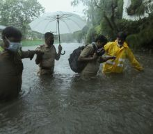 Powerful storm weakens slightly after landfall in western India