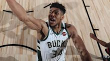 Milwaukee Bucks rally to beat Miami Heat and clinch No 1 seed in Eastern Conference
