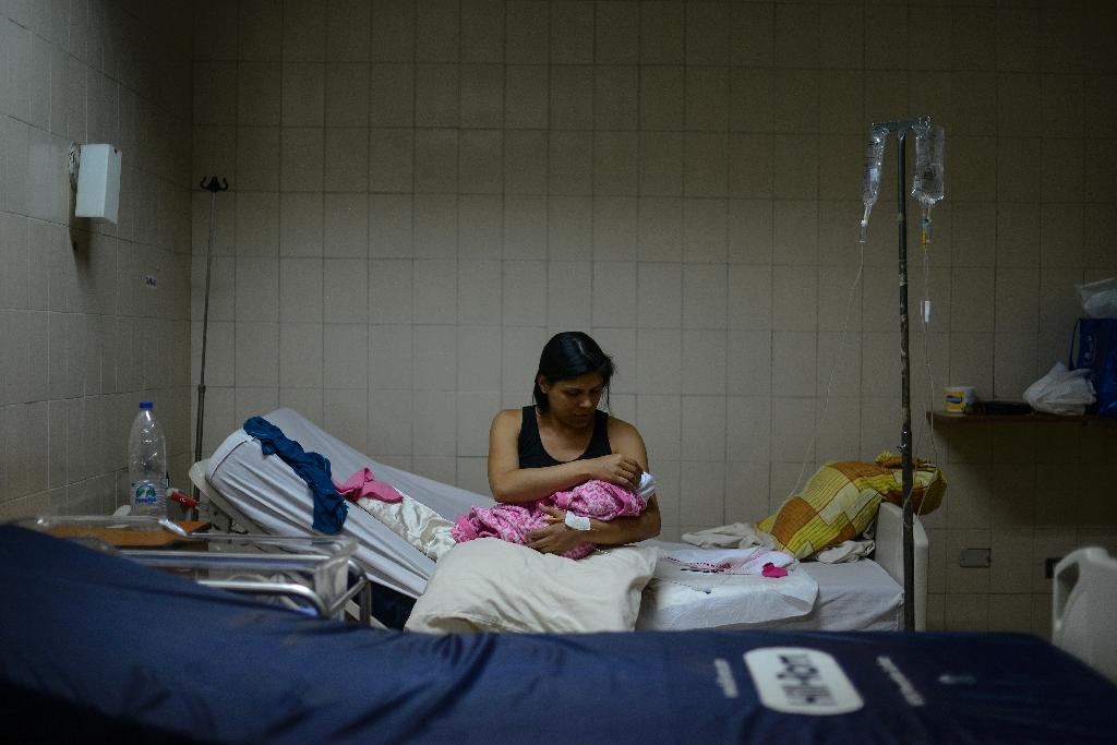 Dayana Soler, 32, waits with her newborn baby daughter for treatment at the Red Cross hospital in Caracas (AFP Photo/Matias Delacroix)
