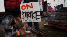 CN Rail dips as workers' strike enters second day, slows factory output