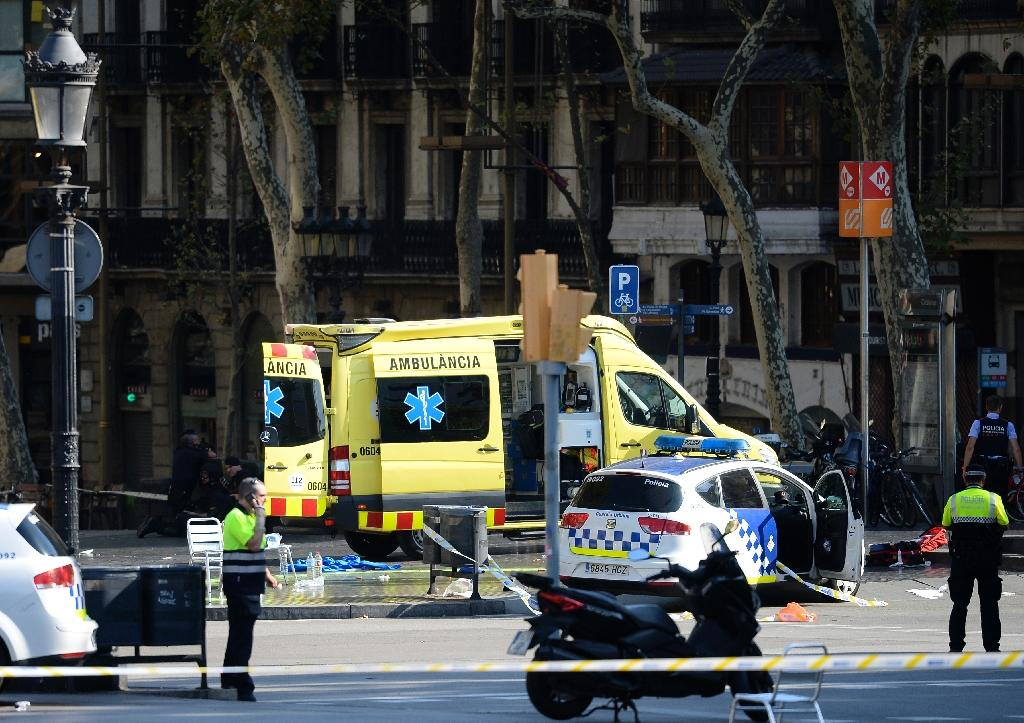 Police cordon off Barcelona's popular Las Ramblas area after a van drives into a crowd of people in what is described as a terrorist attack (AFP Photo/Josep LAGO)