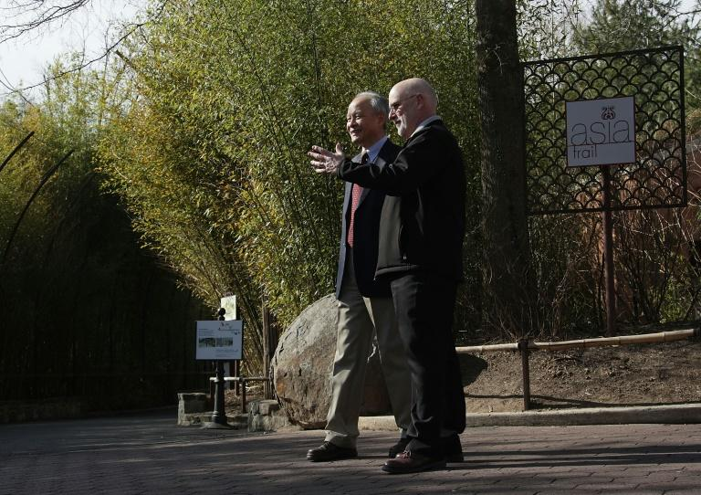 Chinese Ambassador Cui Tiankai (left) speaks to the director of the National Zoo, Dennis Kelly, as they wait for the departure of giant panda Bao Bao in February 2017 (AFP Photo/ALEX WONG)