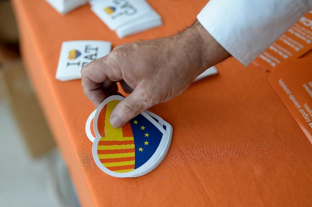 Spanish officials have threatened Catalans will be stripped of their nationality and warned they will plunge into financial chaos like Greece if they break away (AFP Photo/Josep Lago)