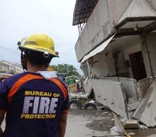 3 dead, 7 missing in building downed by Philippine quake