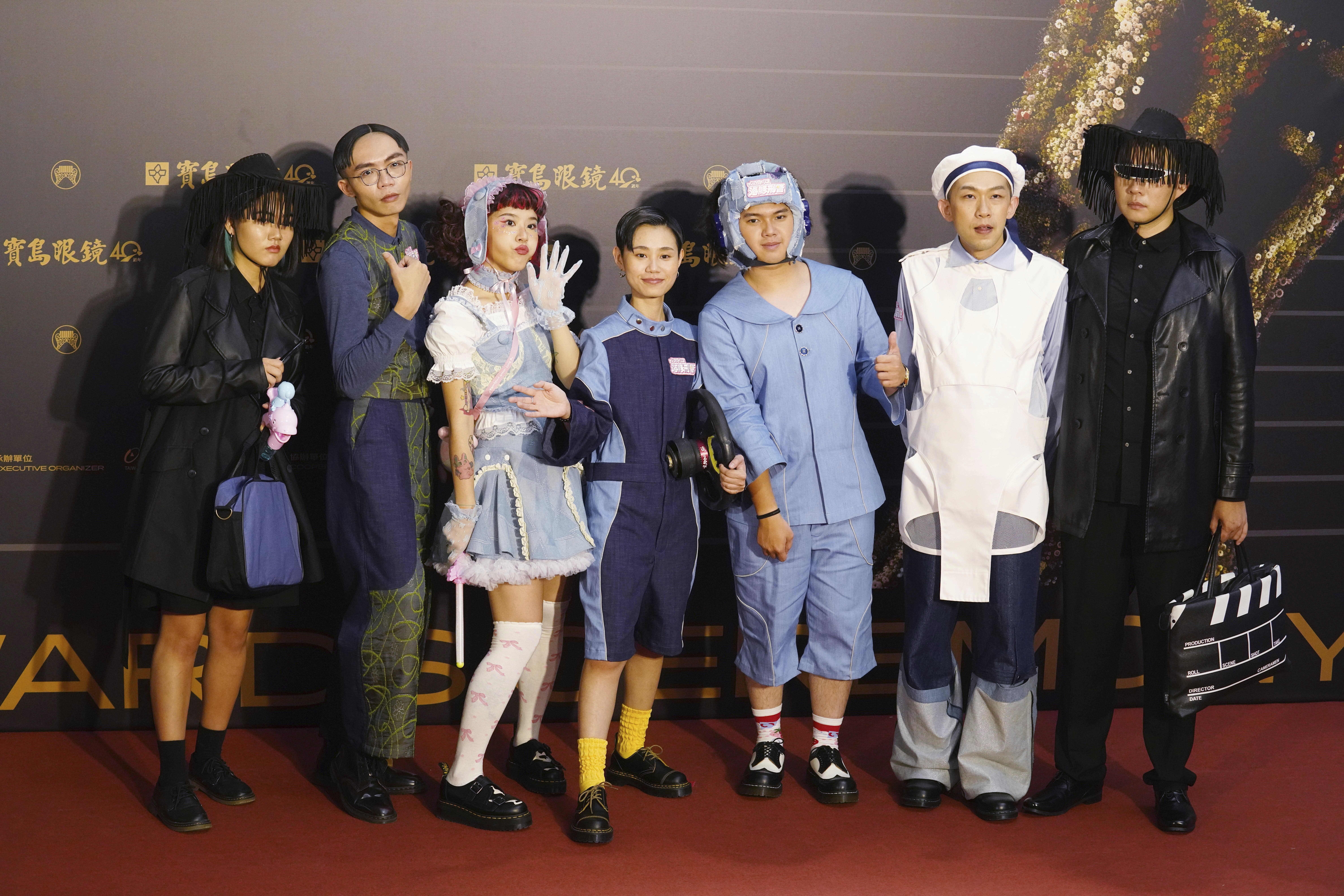 Taiwanese pop group ''Iruka Porisu'' pose as they arrive for the 31th Golden Melody Awards in Taipei, Taiwan, Saturday, Oct. 3, 2020. The awards show, one of the world's biggest Chinese-language pop music annual events was postponed from June to Oct. due to the coronavirus pandemic. (AP Photo/Billy Dai)