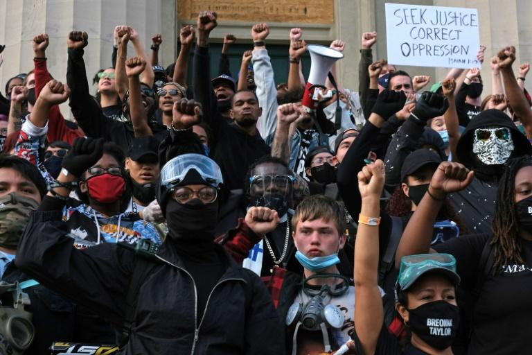 Protesters are seen on the steps of the Louisville Metro Hall on September 24, 2020