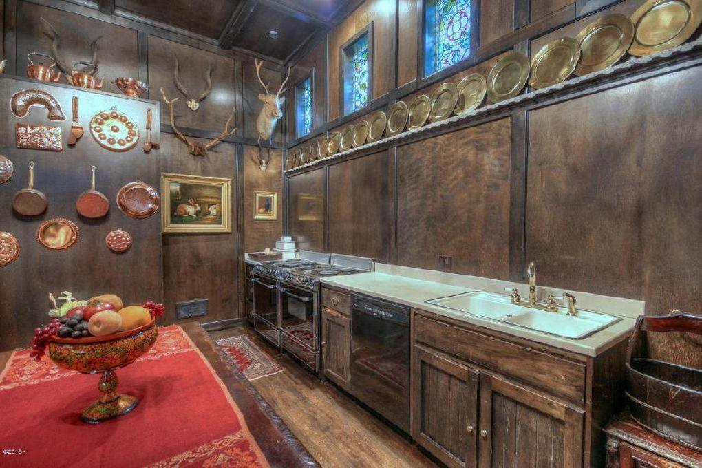 "<p>The kitchen is 45 feet long. The paneling is birch, ""smooth like satin,"" because Barton was concerned that a hardwood would have wild grains, rendering the area too busy-looking.</p>"