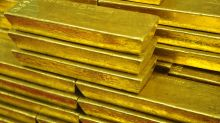 Gold ends higher in delayed settlement; CME blames 'technical issue' for late finish