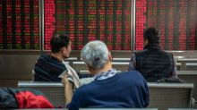 China stocks end higher on strong economic data, while Hang Seng Index drops on protest-hit properties