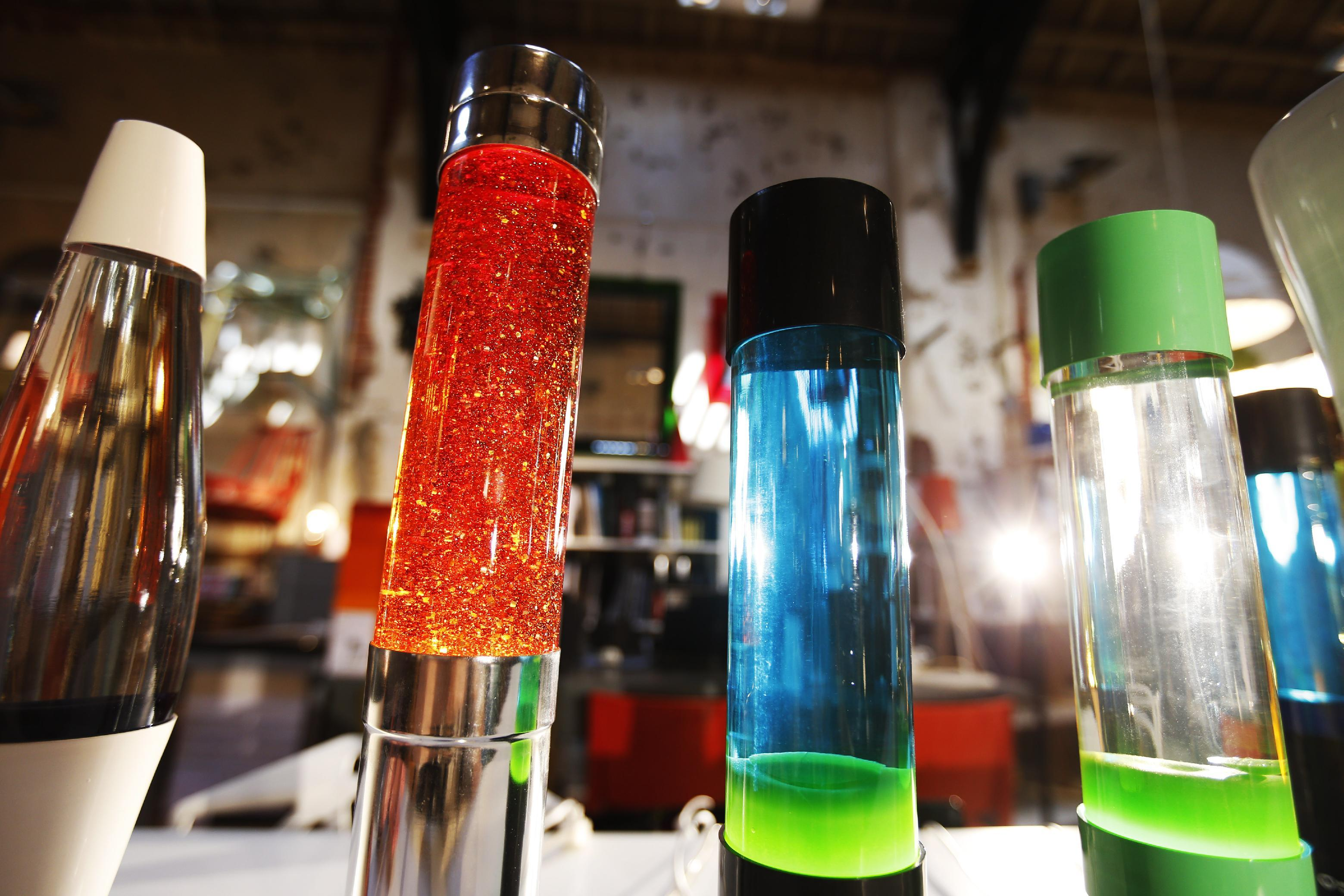 In this Monday, Aug. 19, 2013, lava lamps are photographed in a shop in London. The lava lamp, an iconic piece of British design and social trends, is celebrating its fiftieth birthday. Since its launch in 1963, Mathmos lava lamps have been in continuous production at their factory in Poole, Dorset. The company founder and eccentric inventor Edward Craven-Walker originally developed the lava lamp from an egg timer design he saw in a Dorset pub. (AP Photo/Lefteris Pitarakis)
