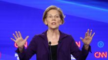Warren, now perceived as the frontrunner, takes hits from the pack