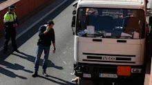 Barcelona police shoot at man driving lorry loaded with butane gas tanks at high speed against traffic