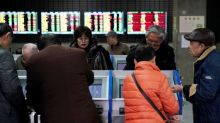 Stocks, oil prices skid as China virus fears drive investors to safe havens
