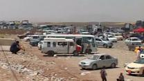 Mass exodus in northern Iraq as Sunni rebels surge towards Baghdad