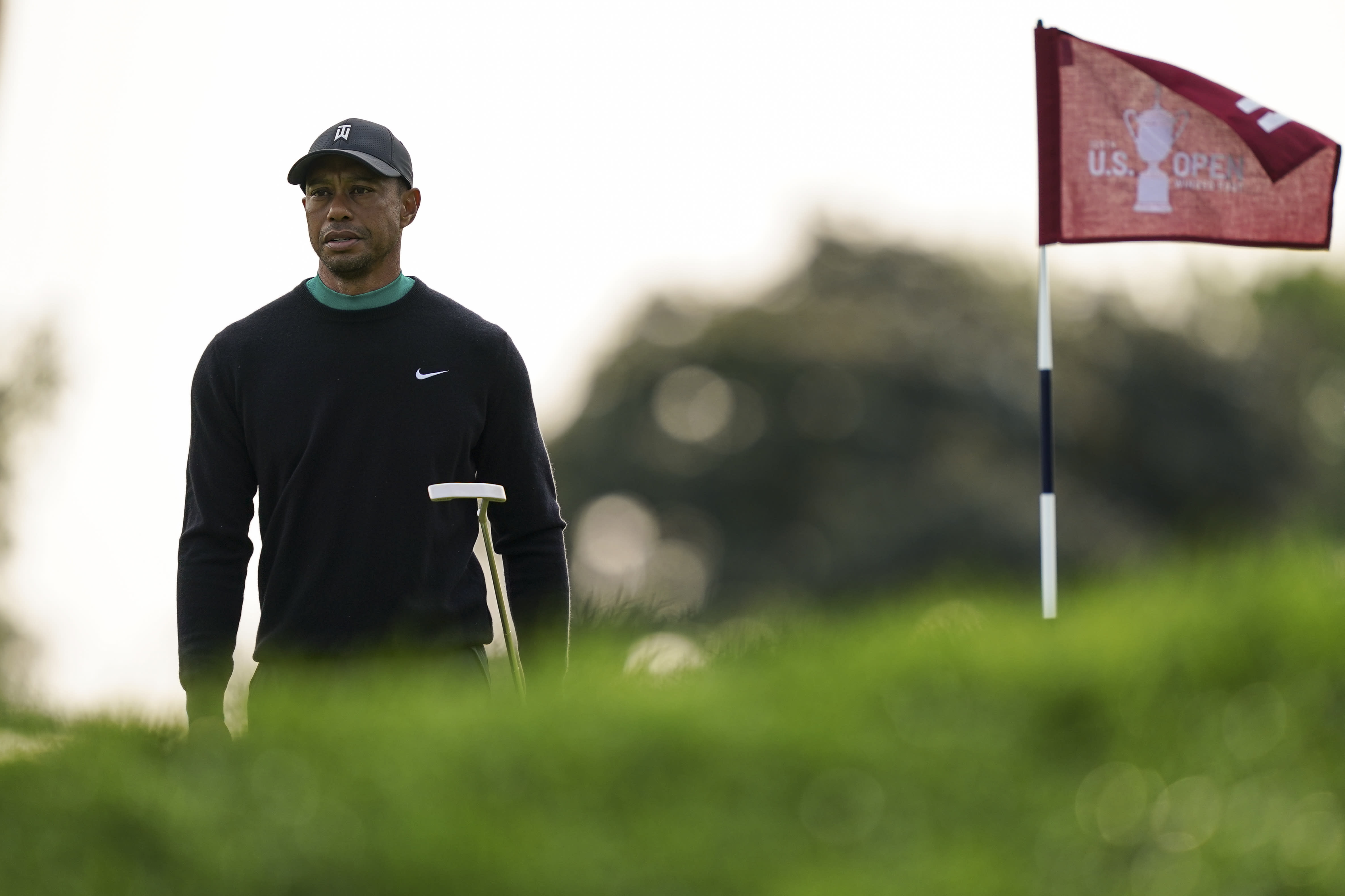 Tiger Woods walks the 11th green during practice before the U.S. Open Championship golf tournament at Winged Foot Golf Club, Tuesday, Sept. 15, 2020, in Mamaroneck, N.Y. (AP Photo/John Minchillo)