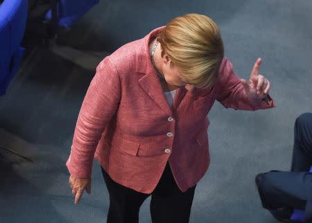 German Chancellor Angela Merkel gestures during a meeting of the lower house of parliament Bundestag on 2017 budget in Berlin, Germany, September 6, 2016. REUTERS/Stefanie Loos