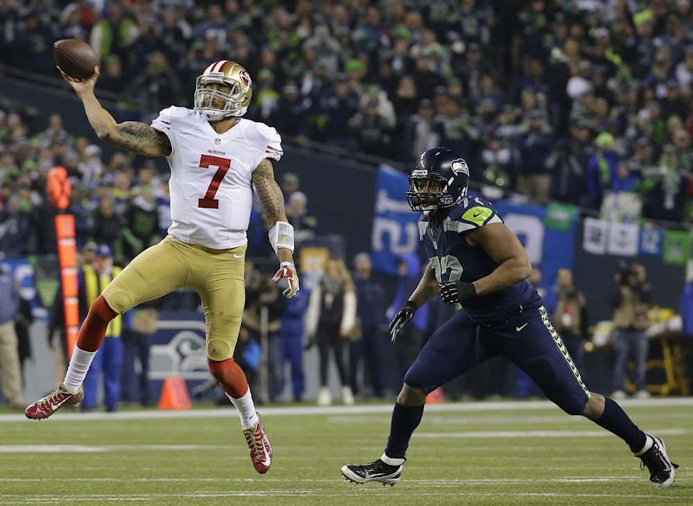 Once adversaries, Michael Bennett (right) says he would welcome Colin Kaepernick to Seattle. (AP)