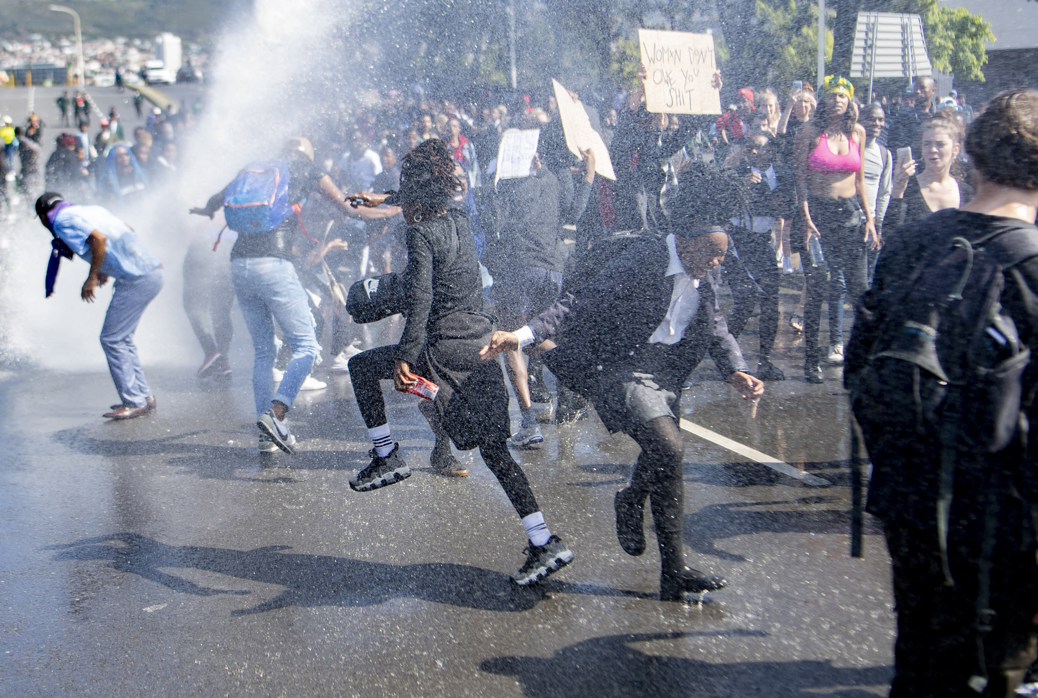 A water cannon is used to disperse demonstrators who were blocking a busy intersection in near to where the World Economic Forum on Africa is being held in Cape Town, South Africa, Wednesday, Sept. 4, 2019. The protesters are demanding that the government crack down on gender-based violence, following a week of brutal murders of young South African women that has shaken the nation. (AP Photo)