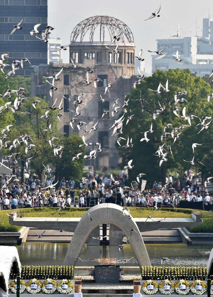 Hiroshima Peace Memorial Park was created in 1954 and includes a concrete memorial cenotaph, pictured here with doves flying above it in 2015, for the 70th anniversary of the atomic bombing of Hiroshima (AFP Photo/Kazuhiro Nogi)