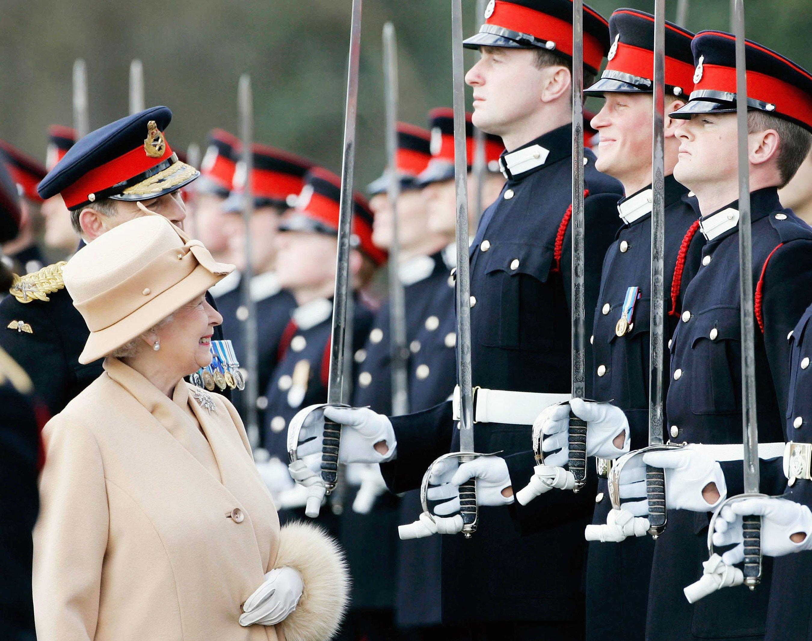 The Queen and Harry share a sweet moment as she inspects soldiers (including her own grandson) at the passing-out Sovereign's Parade at Sandhurst Military Academy in 2006.