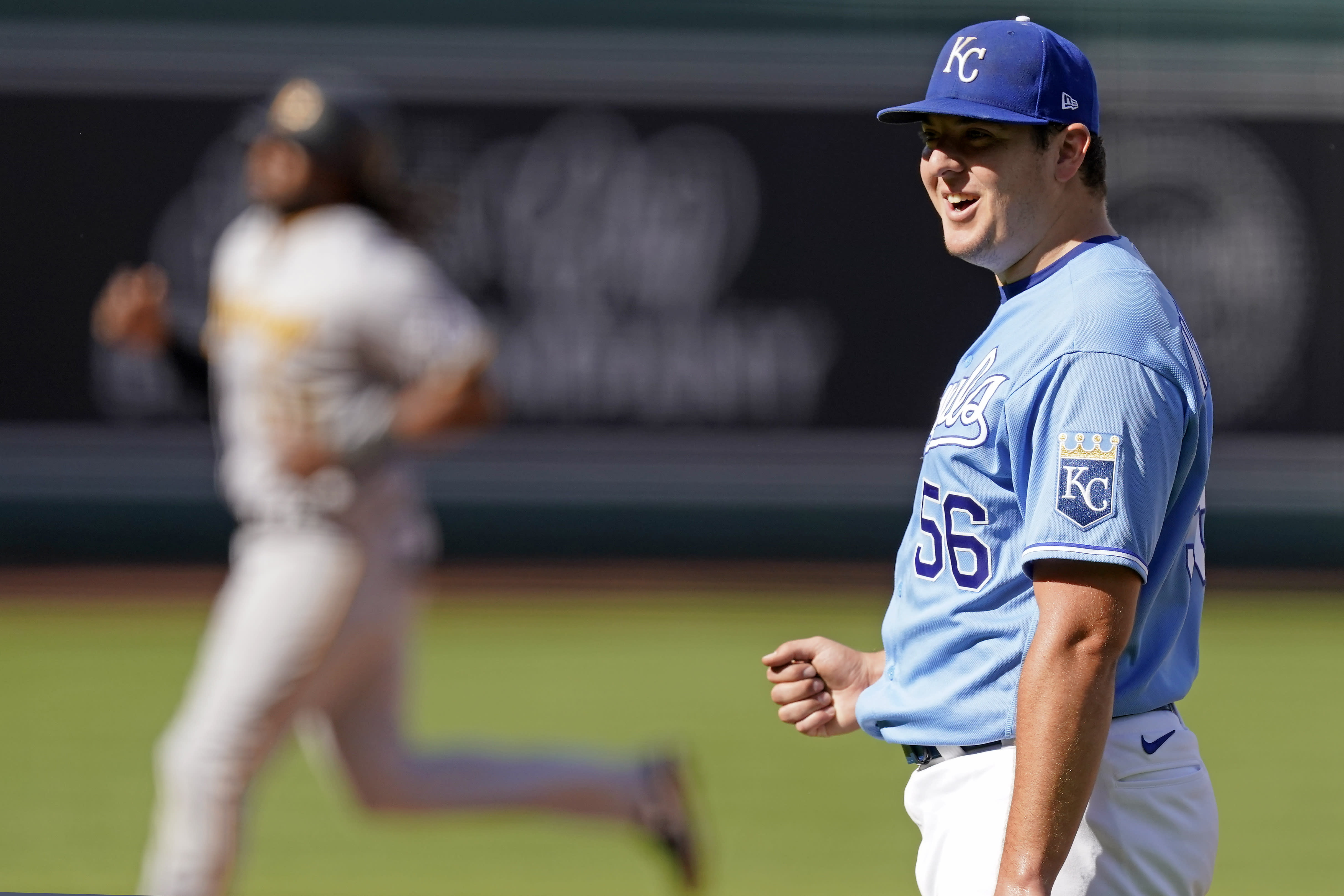 Kansas City Royals starting pitcher Brad Keller reacts after a baseball game against the Pittsburgh Pirates Sunday, Sept. 13, 2020, in Kansas City, Mo. Keller pitched a complete game and shut out the Pirates. (AP Photo/Charlie Riedel)