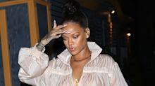 Only Rihanna could pull off a sheer raincoat as a dress