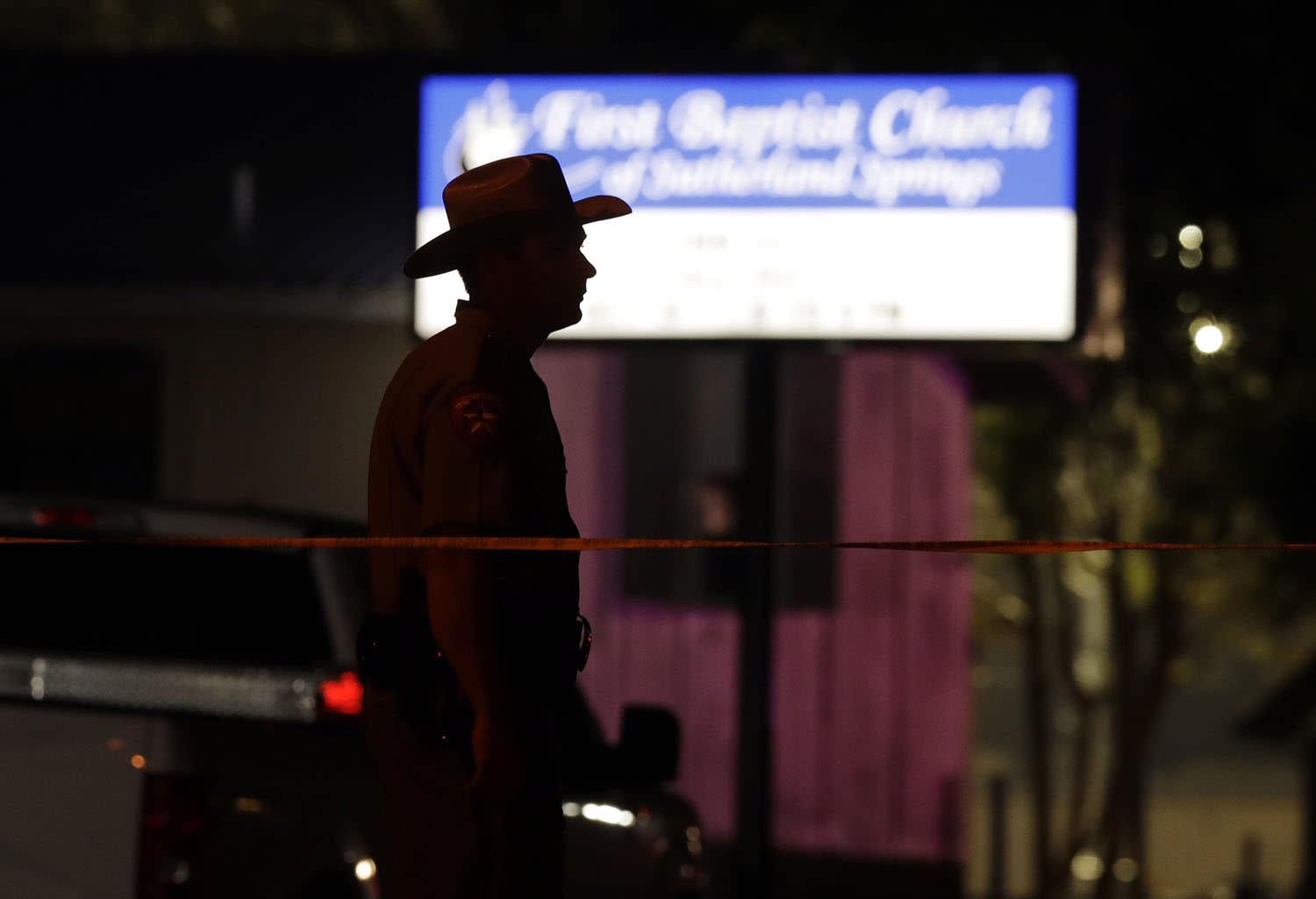 <p>A law enforcement official stands watch outside the First Baptist Church of Sutherland Springs, the scene of a mass shooting, Nov. 5, 2017, in Sutherland Springs, Texas. (Eric Gay/AP) </p>