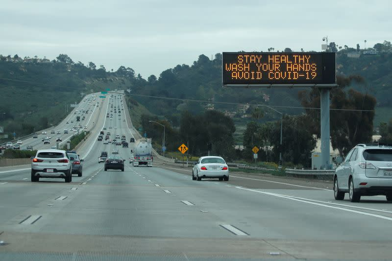 A traffic highway sign on a usually busy interstate 5 freeway informs drivers to wash their hands due to the global outbreak of the coronavirus disease (COVID-19), in La Jolla