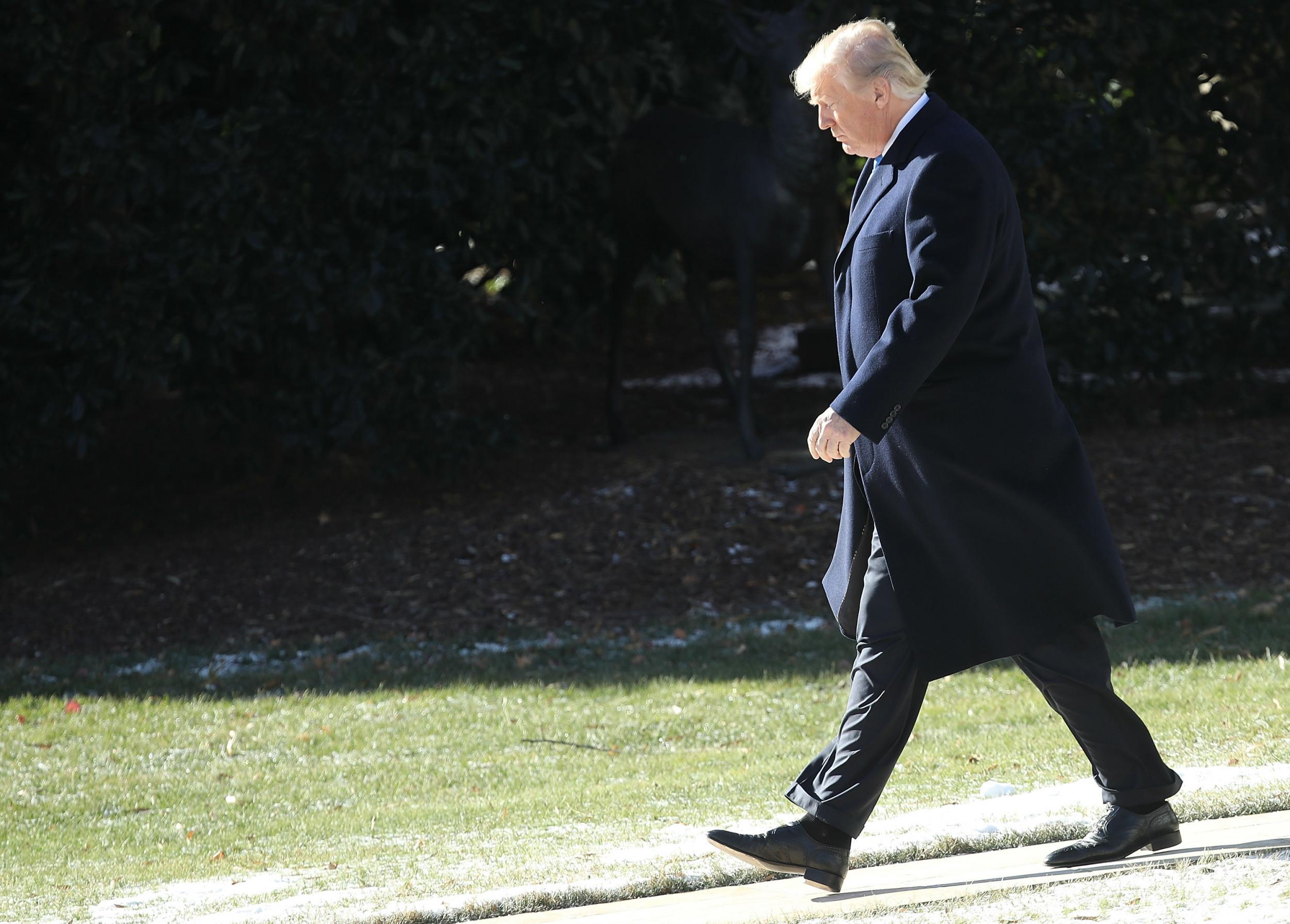 Trump retreats to the woods of Camp David with Wolff on his tail
