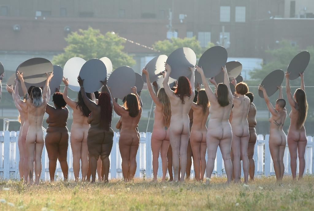 "Spencer Tunick's art installation ""Everything She Says Means Everything,"" featured women holding up mirrors toward the arena where Republicans this week are set to formally name billionaire Donald Trump as their presidential nominee (AFP Photo/Timothy A. Clary)"