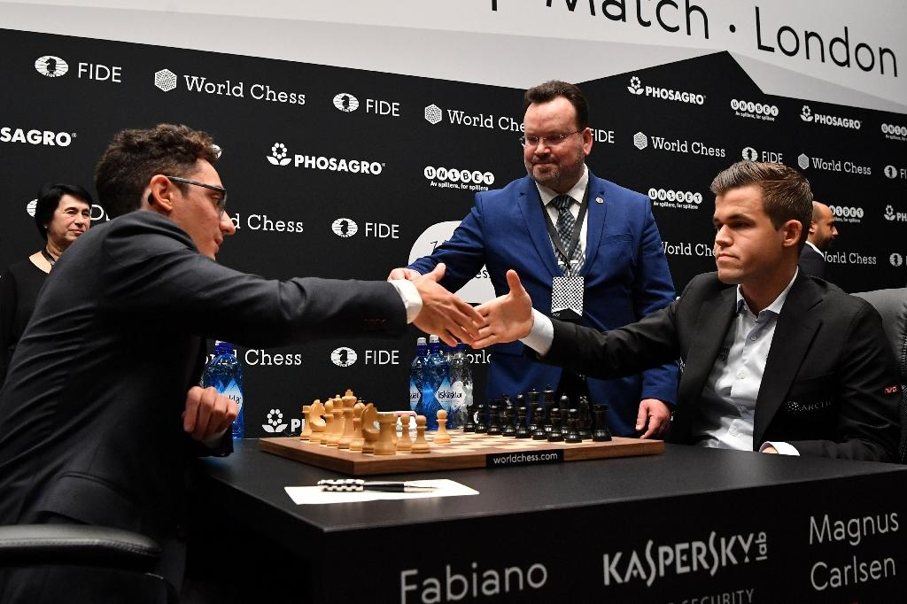 Carlsen (r) and US challenger Caruana have drawn each of the 12 games they have played in the final