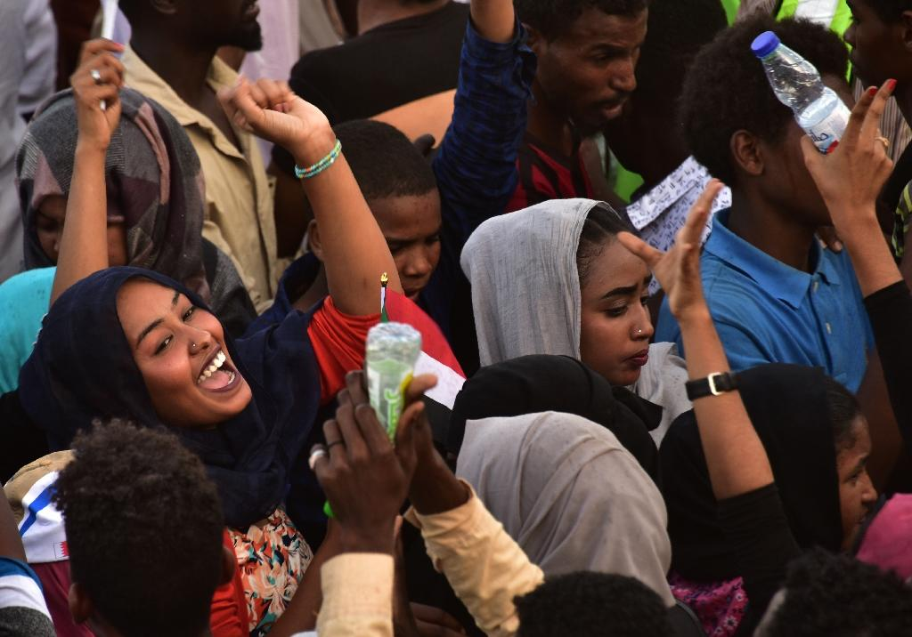 Sudanese women celebrate concessions to protesters made by Sudan's new military council on Saturday