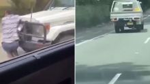 'Going to kill him': Man clings for life on bullbar as ute drives through Sydney