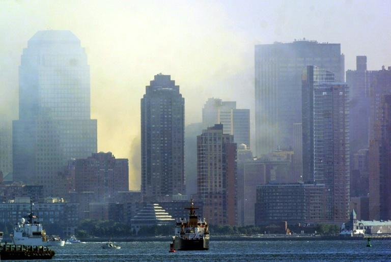 After the collapse of the Twin Towers, a cloud hung over lower Manhattan (AFP Photo/DOUG KANTER)