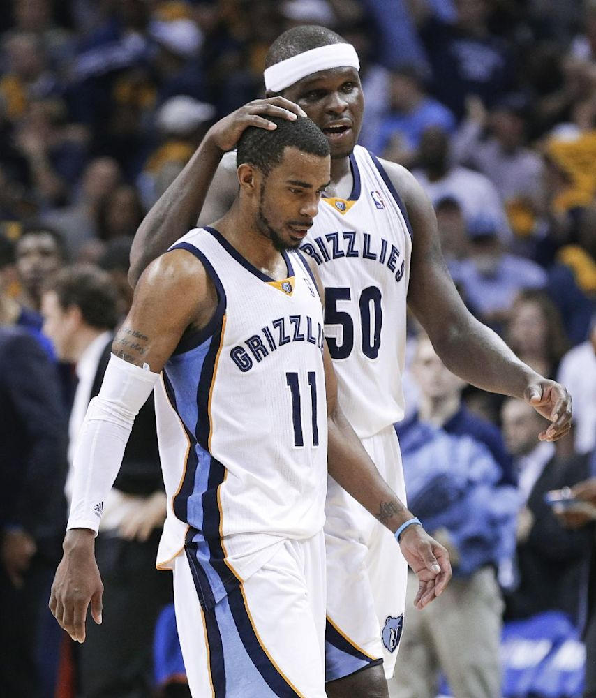 Memphis Grizzlies forward Zach Randolph (50) celebrates with Mike Conley (11) in the final seconds of the Grizzlies' 98-95 overtime win against the Oklahoma City Thunder in Game 3 of an opening-round NBA basketball playoff series Thursday, April 24, 2014, in Memphis, Tenn