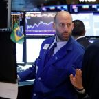 Wall St flat as losses in financials offset healthcare gains