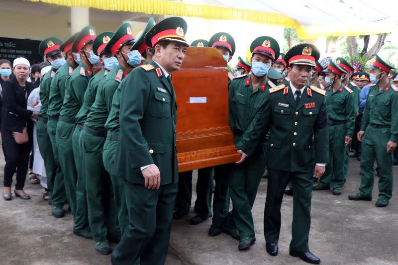 Landslide hits barracks in Vietnam, killing 14 and leaving 8 missing
