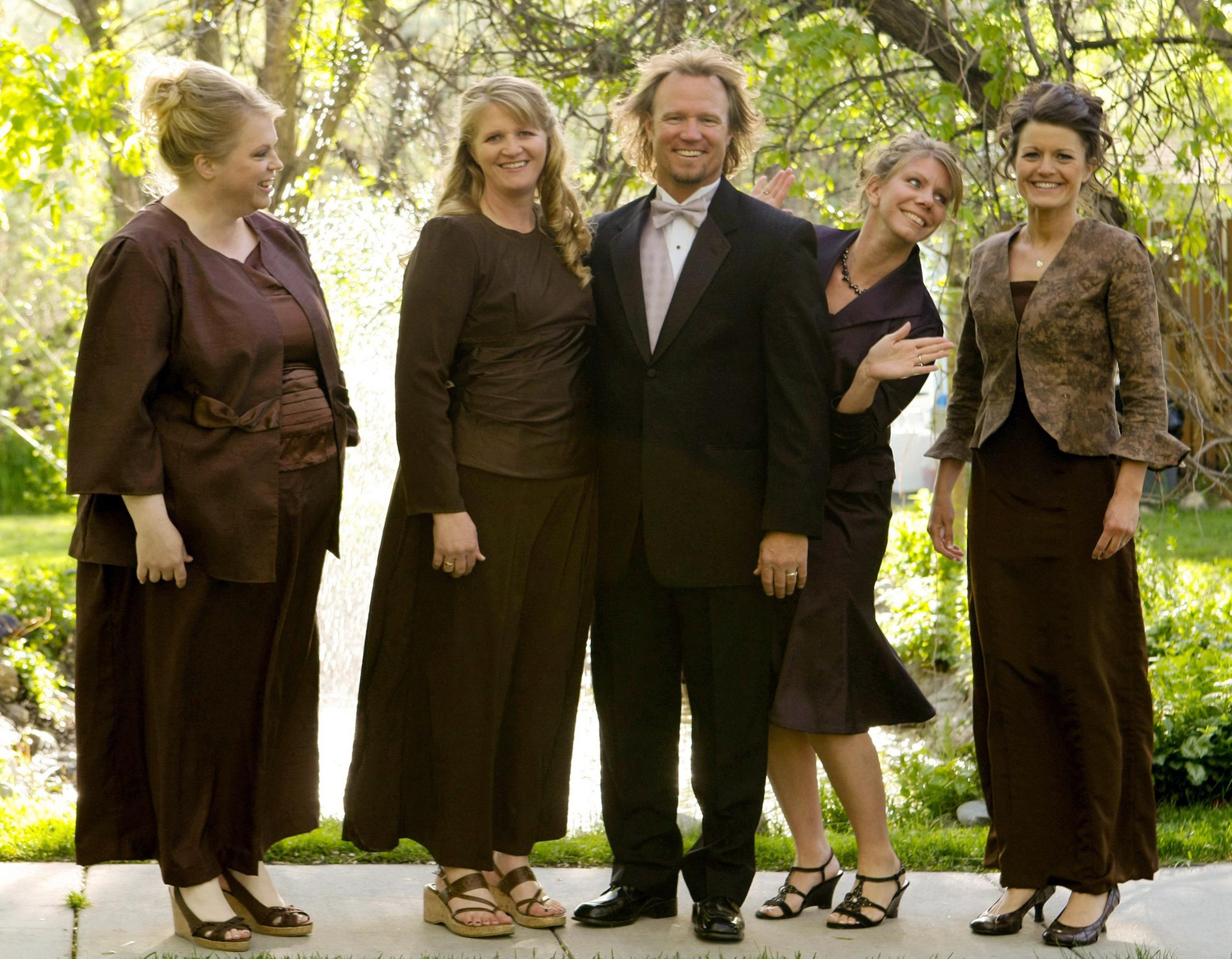 """FILE - In this undated file photo provided by TLC, Kody Brown, center, poses with his wives, from left, Janelle, Christine, Meri, and Robyn in a promotional photo for TLC's reality TV show, """"Sister Wives."""" A Utah county attorney says he will not pursue criminal charges against this polygamous family made famous by a reality TV show. A federal judge is set to decide whether to allow a lawsuit to move forward that challenges the constitutionality of Utah's bigamy law. (AP Photo/TLC, Bryant Livingston, File)"""