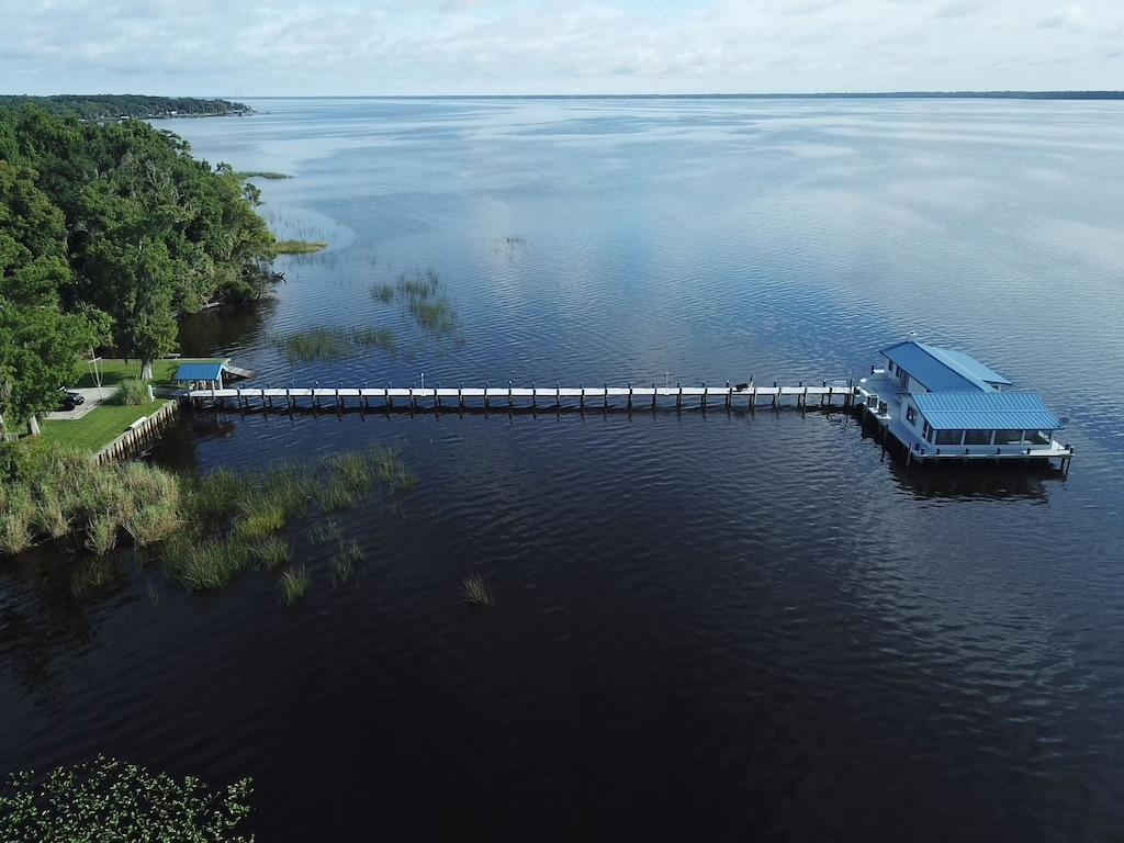 """<p>So you can't fly to the Maldives for vacay this year (bummer, right!?). But you <em>can</em> sleep in an overwater bungalow with 360-degree water views. This little cottage is perched at the end of a 250-foot-long dock in the middle of Florida's Crescent Lake (just west of Daytona Beach). If you're an angler, the two-bedroom home is even more appealing: According to the listing, freshwater fishing is good almost year-round, particularly with large-mouth bass.</p> <p><strong>Rent it:</strong> $265 per night; <a href=""""https://www.kqzyfj.com/click-7885610-10697641?sid=SLTRVSecludedSouthernRentalHomesmspykerprintedAug20&url=https%3A%2F%2Fwww.vrbo.com%2F333819ha"""" rel=""""nofollow noopener"""" target=""""_blank"""" data-ylk=""""slk:vrbo.com"""" class=""""link rapid-noclick-resp"""">vrbo.com</a></p>"""