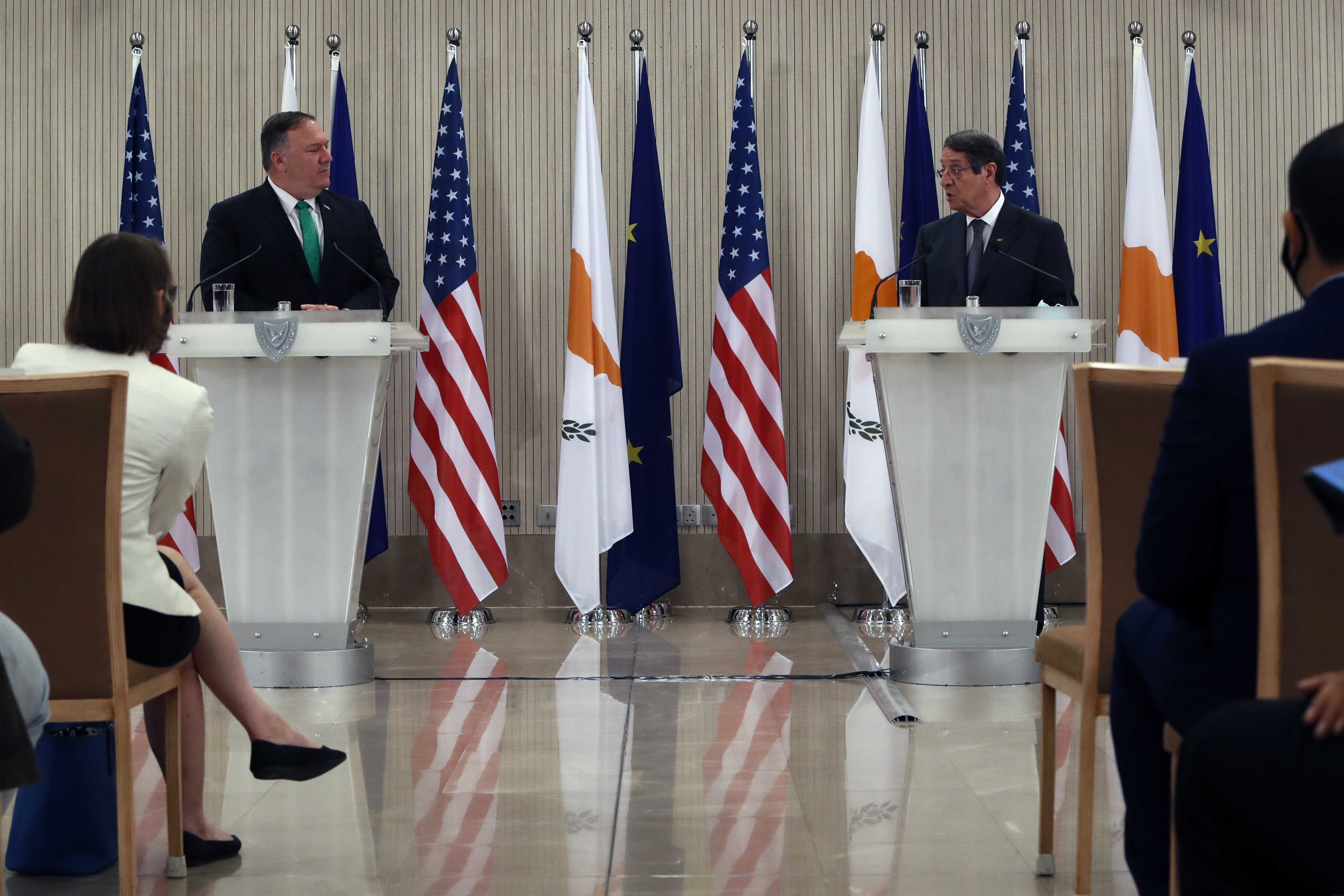 U.S. Secretary of State Mike Pompeo, left, Cypriot President Nicos Anastasiades make statements during a press conference at the Presidential Palace in Nicosia, Cyprus, Saturday, Sept. 12, 2020. Pompeo's lightning visit to Cyprus aimed to de-escalate a confrontation between Greece and Turkey over energy reserves in east Mediterranean waters and to affirm Washington's continued engagement in the tumultuous region four days after Russian Foreign Minister Sergey Lavrov pitched Moscow's offer to help ease tensions during his trip to the island nation. (AP Photo/Petros Karadjias, Pool)