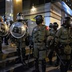 Foreign Experts Exit Hong Kong Police Probe After Disputes