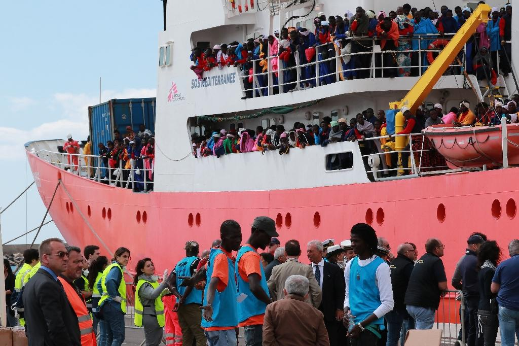 Almost 100,000 people have crossed from Libya to Italy in 2017 alone, but over 2,000 have died during the passage, creating a need for rescue ships (pictured in May 2017) and prompting Rome to ask the EU for help, which the EU has agreed to provide (AFP Photo/CARLO HERMANN)