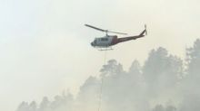 Colorado wildfire grows, firefighters gain on New Mexico blaze