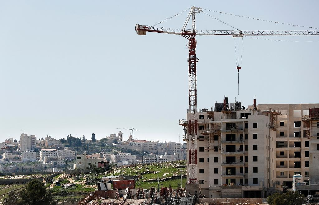 A general view shows buildings under construction in the Israeli settlement of Har Homa in annexed east Jerusalem, on March 7, 2016 with the West Bank city of Bethlehem in the background (AFP Photo/Thomas Coex)