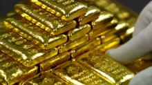 Gold falls to one-month low on stronger dollar