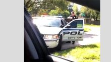 Woman who filmed Florida police officer drawing gun during pullover arrested after failing to return vehicle