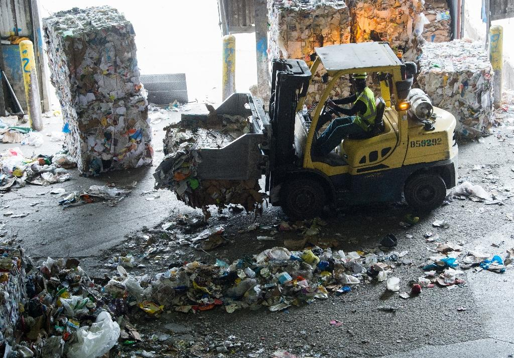 At a recycling facility in the Baltimore-Washington area, bales of compacted plastics and paper are cluttering the plant because China is not buying it as they once did (AFP Photo/SAUL LOEB)