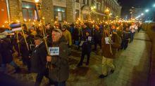 Estonia's far-right junior govt party holds torchlight march