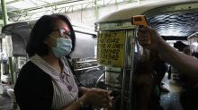 The Latest: Philippines coronavirus cases top 100,000